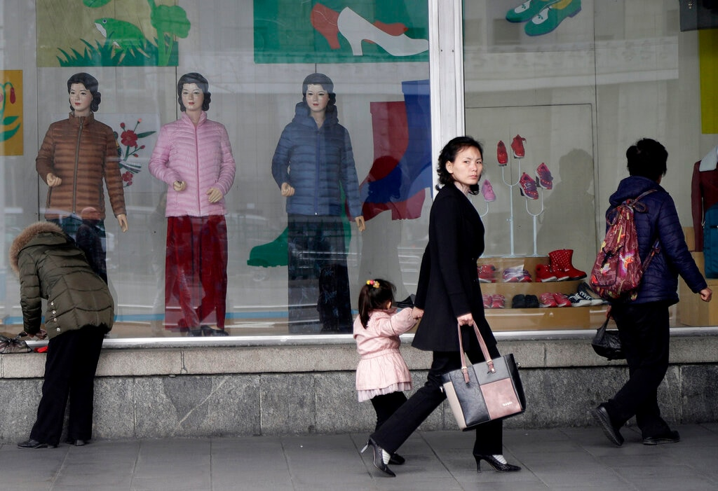 A woman walks past mannequins displayed at a department store in downtown Pyongyang, North Korea, Monday, March 11, 2019. (AP Photo/Dita Alangkara)