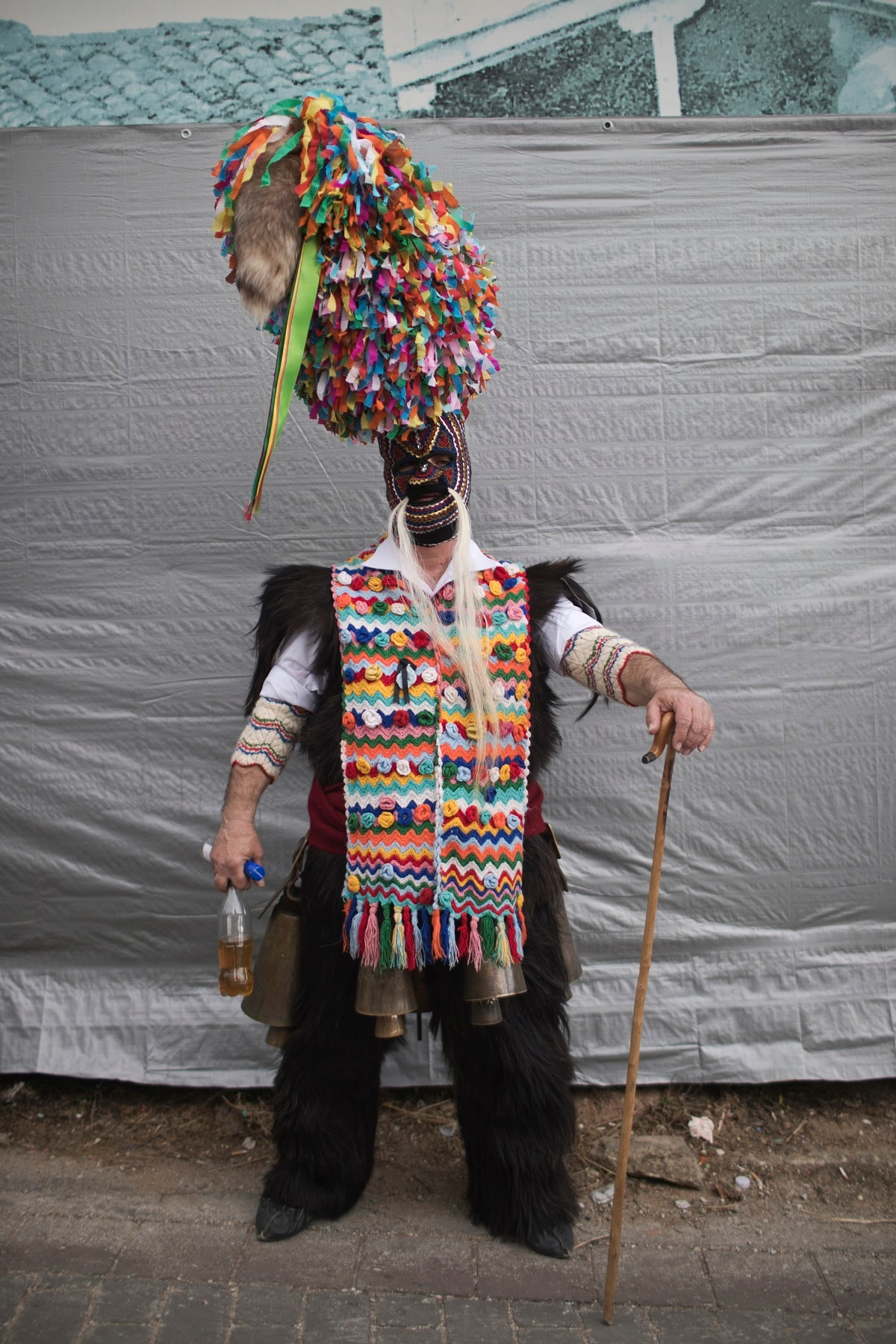 A man poses for a photo as he participates in a Clean Monday festival. (AP Photo/Petros Giannakouris)