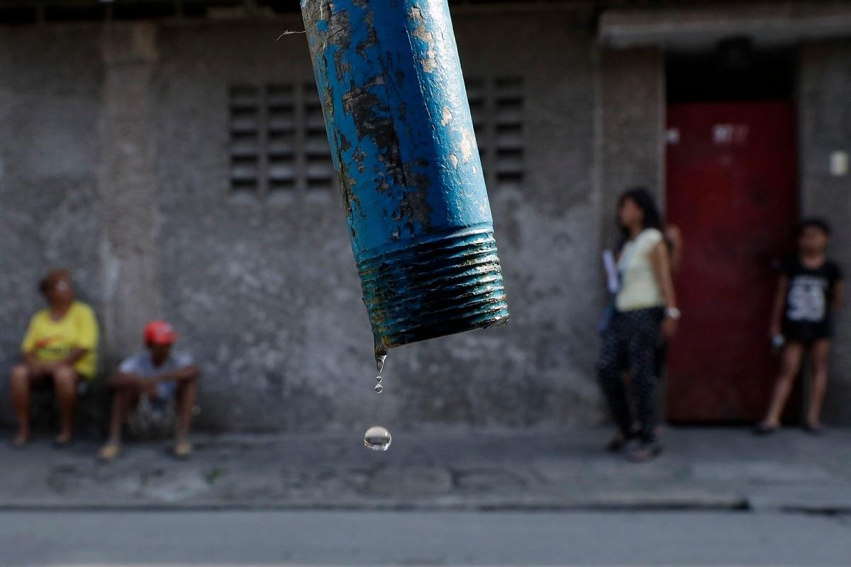 Water drops from a faucet as residents wait for trucks bearing water to return in Mandaluyong, metropolitan Manila. (AP Photo/Aaron Favila)
