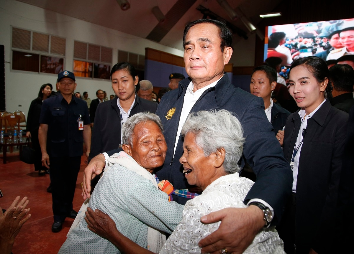 Elderly locals hug Prime Minister Prayuth Chan-ocha and candidate for the same position, as he attends a government-sponsored event in Nakhon Ratchasima, Thailand. Prayuth has been nominated by a pro-army political party to become prime minister again after the March 24 general election. (AP Photo/Sakchai Lalit)
