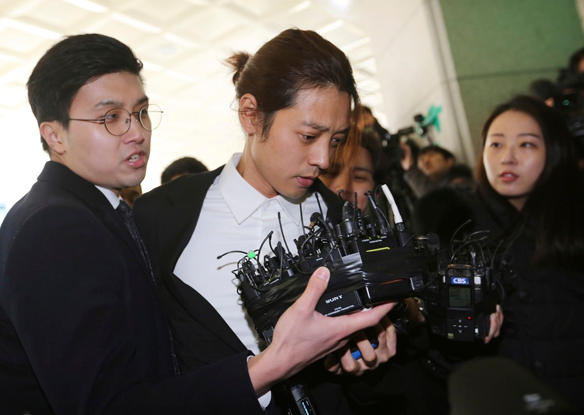 K-pop singer Jung Joon-young, center, arrives at the Seoul Metropolitan Police Agency in Seoul, South Korea. Police have alleged Jung secretly filmed himself having sex with about 10 women and shared the footage with friends by a mobile messenger app. (AP Photo/Ahn Young-joon)