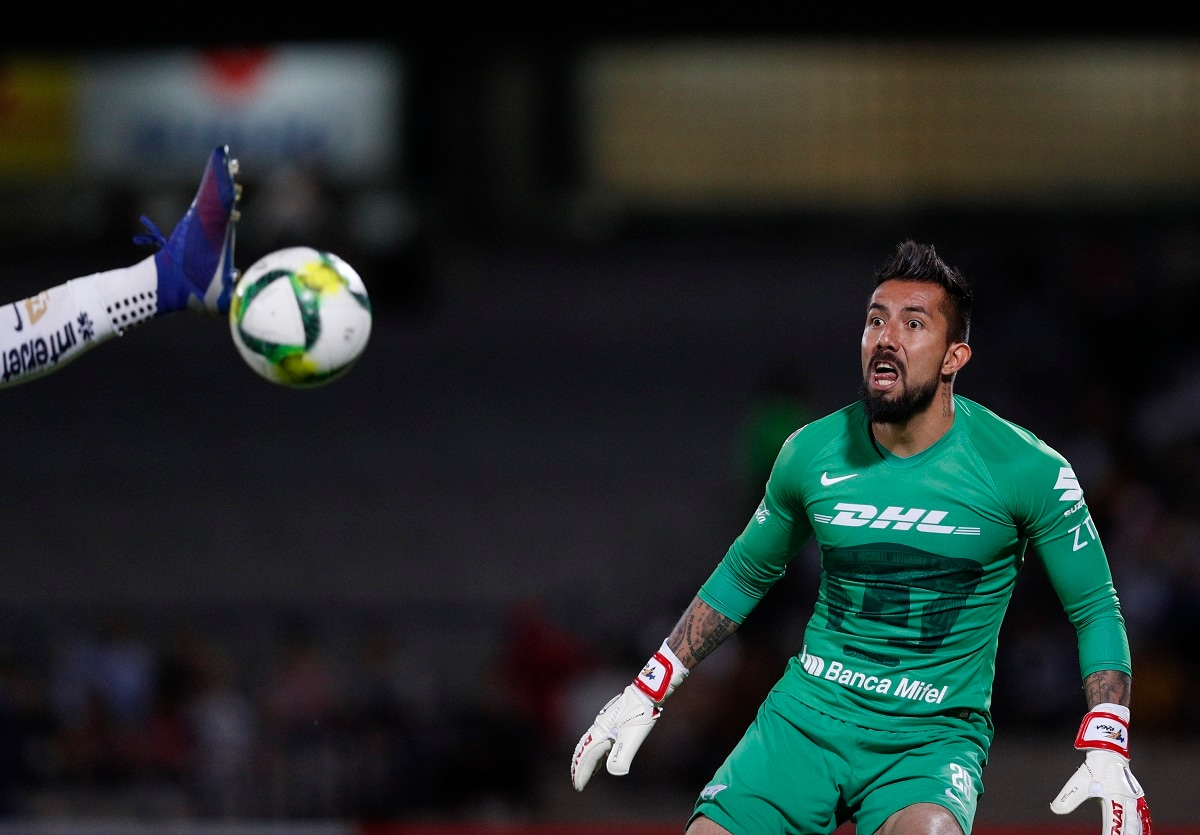 Pumas goalkeeper Miguel Fraga watches as a scoring attempt by Dorados is intercepted by teammate Alan Mendoza, in their Copa MX quarterfinal match at the Olympic University Stadium in Mexico City. Pumas won 3-0 drawing them one step closer to the trophy. (AP Photo/Rebecca Blackwell)