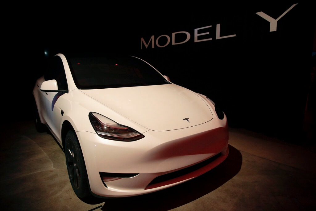 Tesla's Model Y is displayed at Tesla's design studio on Thursday, March 14, 2019, in Hawthorne, Calif. The Model Y may be Tesla's most important product yet as it attempts to expand into the mainstream and generate enough cash to repay massive debts that threaten to topple the Palo Alto, California, company. (AP Photo/Jae C. Hong)