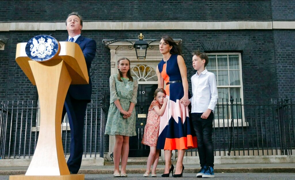 In this Wednesday, July 13, 2016 file photo, Britain's Prime Minister David Cameron, speaks to the media as his wife Samantha and their children Nancy, Florence and Elwen, from left, look on as they leave 10 Downing Street, in London after he resigned. (AP)