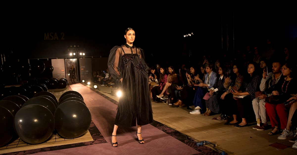 A model displays a creation by designers Pankay and Nidhi. (AP Photo/Manish Swarup)