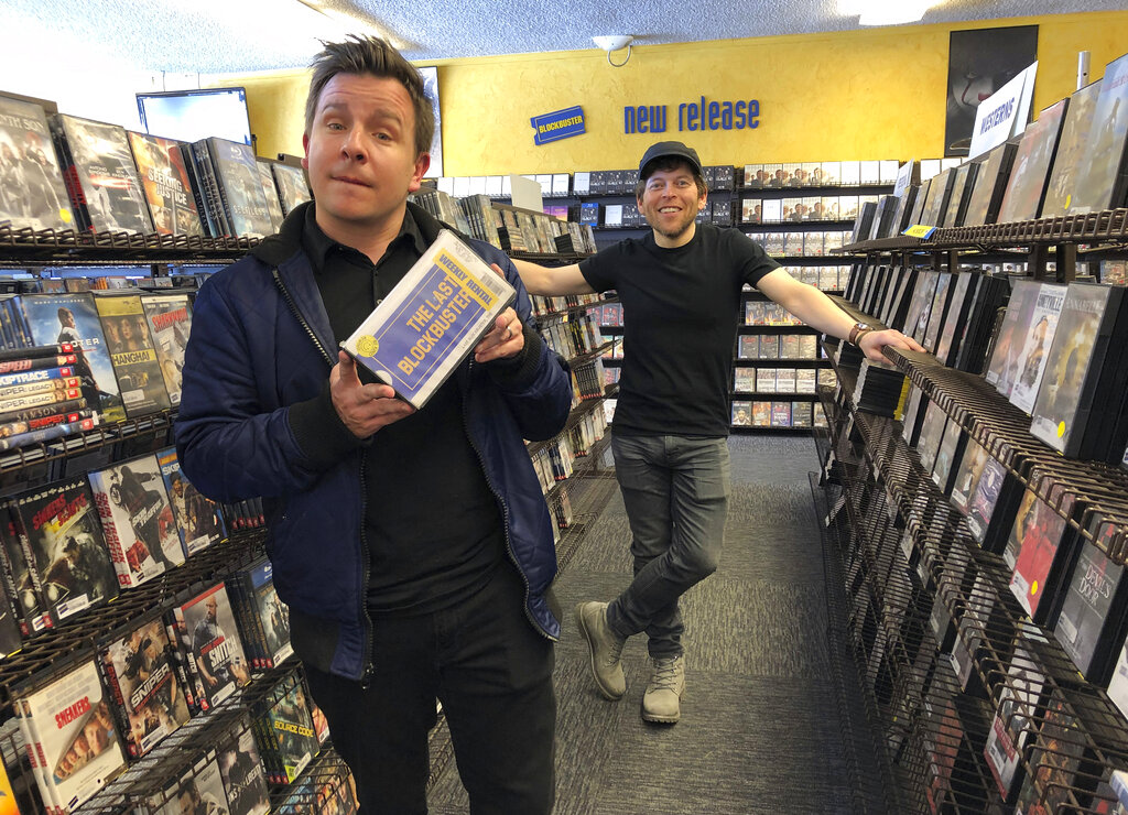 Local documentary filmmakers Taylor Morden, left, and Zeke Kamm, pose at the last Blockbuster on the planet in Bend, Ore., on Monday, March 11, 2019, with a promotional VHS tape of their upcoming documentary about the store titled The Last Blockbuster. When a Blockbuster in Perth, Australia, shuts its doors for the last time on March 31, the store in Bend, Ore., will be the only one left on Earth, and most likely in the universe. (AP)