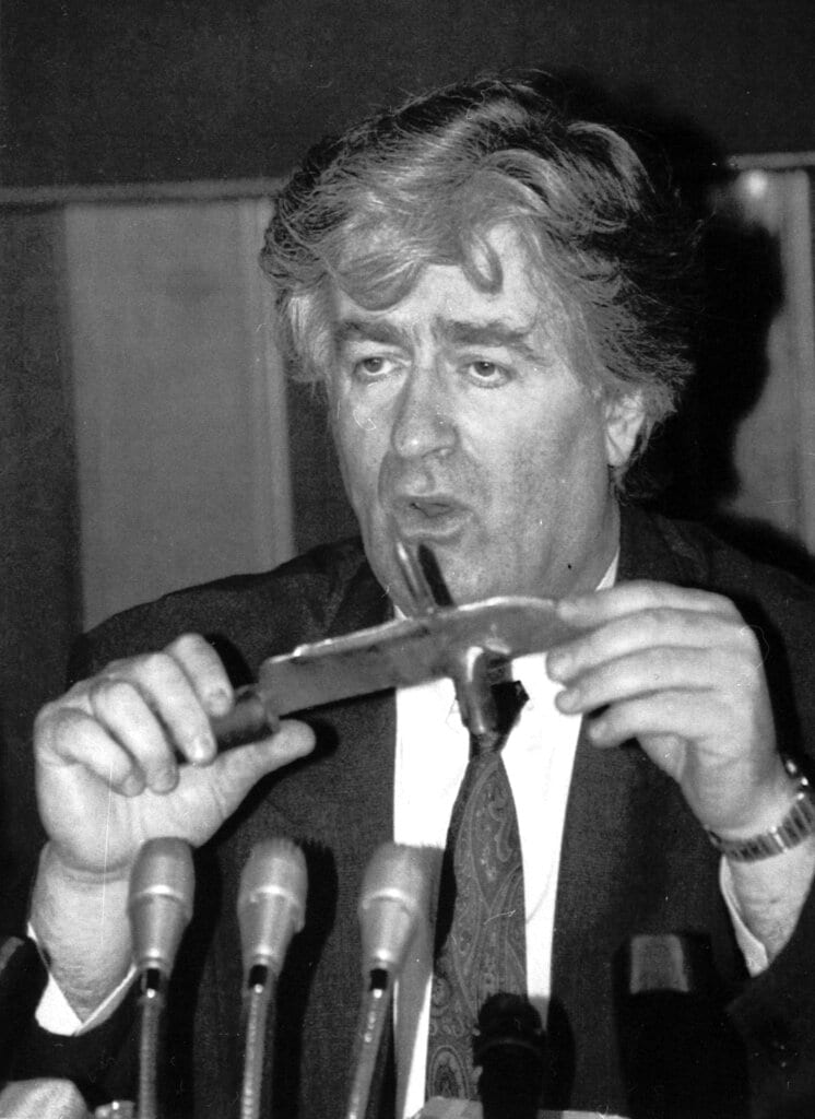 In this Sept. 23, 1992 file photo, Bosnian Serb leader Radovan Karadzic holds a knife he said was seized from Bosnian Croat soldiers in Bosnia during a news conference in Belgrade, Yugoslavia.(AP Photo/File)