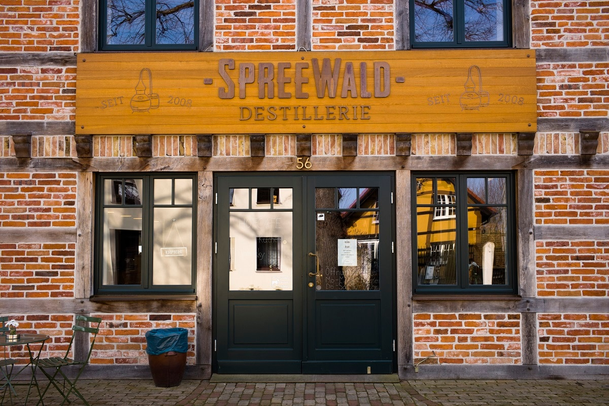 A wooden nameplate displayed on the main entrance of a historical reconstructed building of the German whiskey maker Spreewood Distillery in Schlepzig, Germany. (AP Photo/Markus Schreiber)