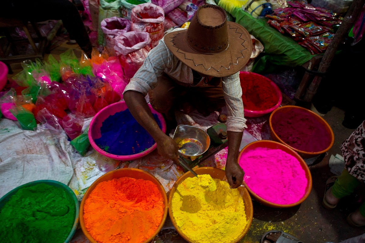 A street vendor sells coloured powder a day ahead of Holi, the festival of colours, in Gauhati. Holi also marks the advent of Spring season. (AP Photo/Anupam Nath)