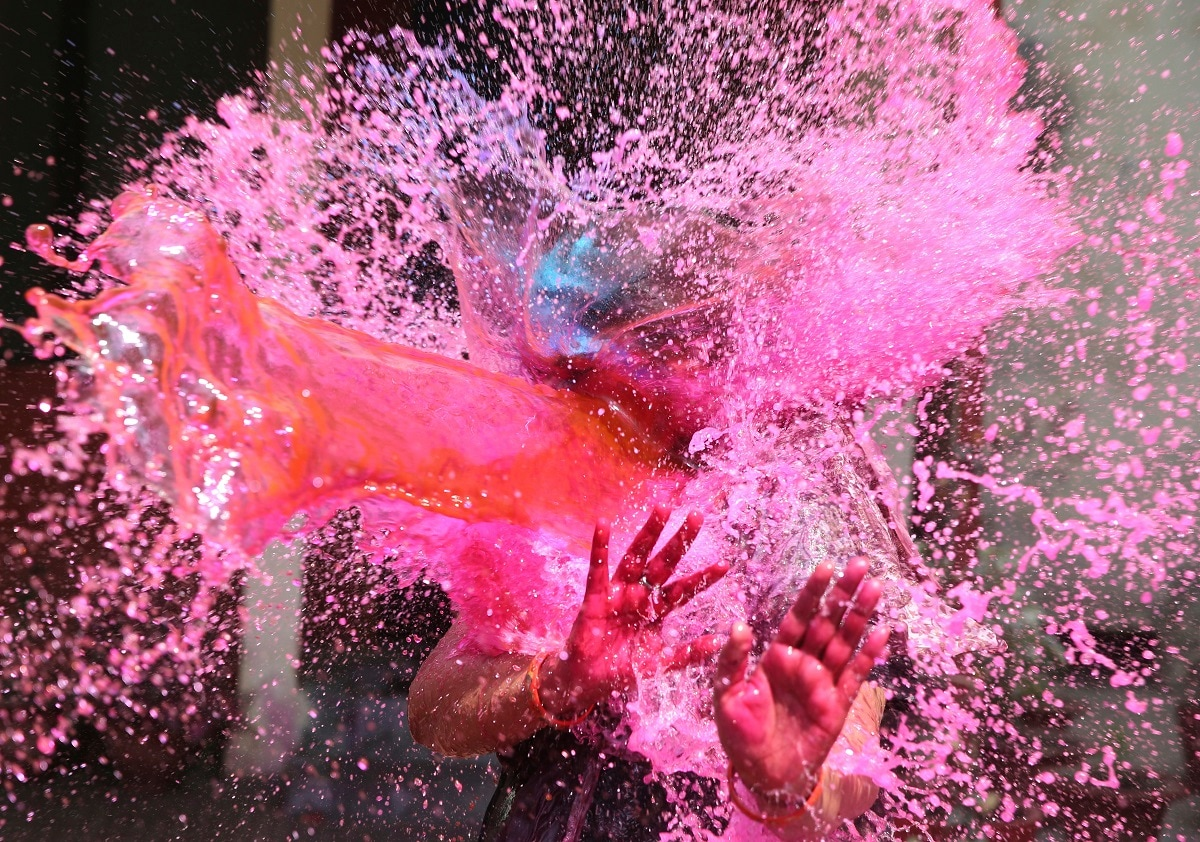A girl gestures with her hands as coloured water is splashed on her during Holi festival in Allahabad. (AP Photo/Rajesh Kumar Singh, File)