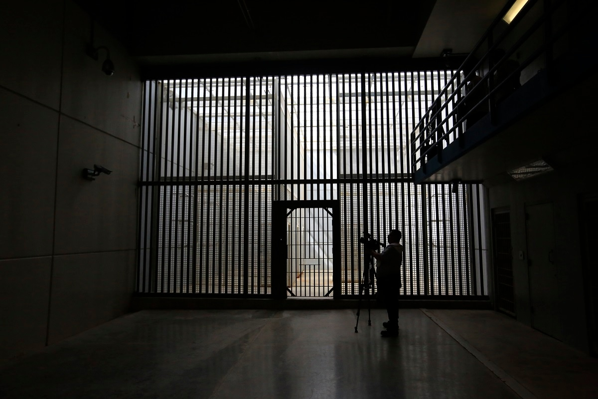 A journalist films the now-closed Laguna del Toro maximum security facility during a media tour of the former Islas Marias penal colony located off Mexico's Pacific coast. Bars and cells were limited to the maximum security facility because the surrounding ocean effectively prevented escape. (AP Photo/Rebecca Blackwell)