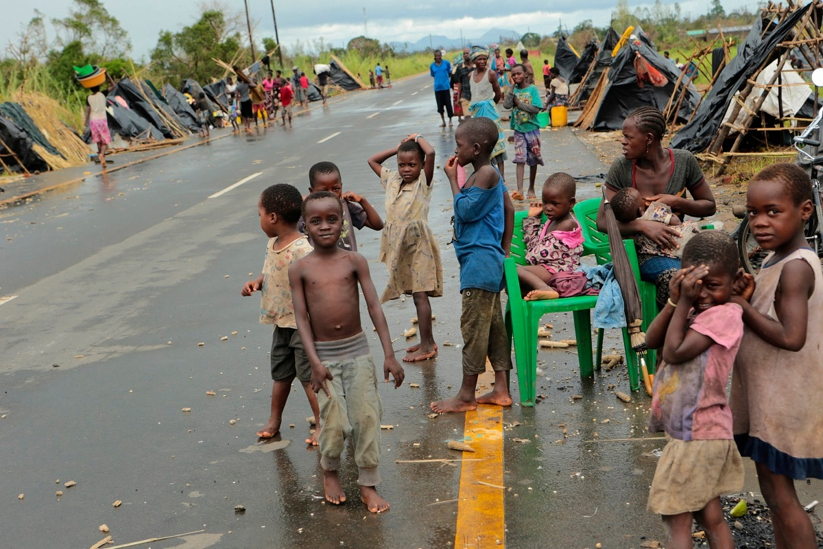 Survivors of Cyclone Idai in a makeshift shelter by the roadside. (AP Photo/Tsvangirayi Mukwazhi)
