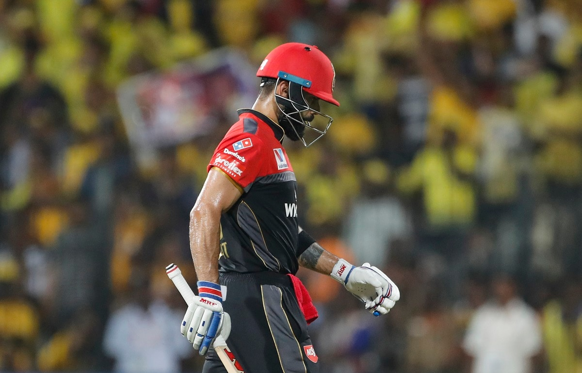 Royal Challengers Bangalore captain Virat Kohli leaves the field after being dismissed. (AP Photo/Aijaz Rahi)