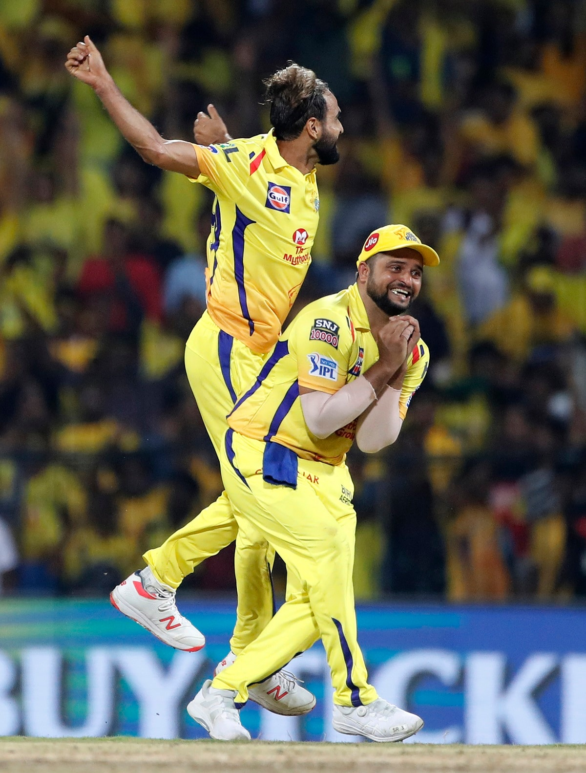 Chennai Super Kings' Imran Tahir, left, and Suresh Raina celebrates the dismissal of Royal Challengers Bangalore's Yuzvendra Chahal. (AP Photo/Aijaz Rahi)