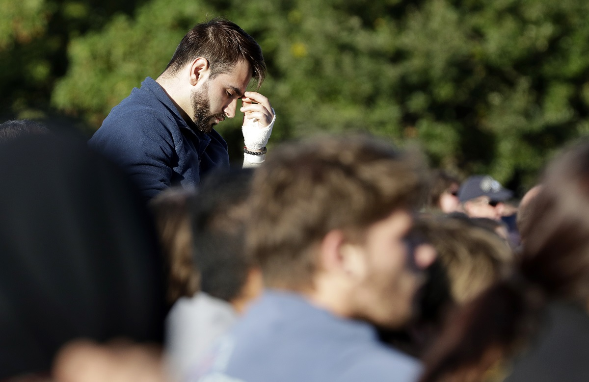 Mustafa Boztas, a survivor of March 15 mosque shootings attends a vigil in Hagley Park following the mass shooting in Christchurch. (AP Photo/Mark Baker)