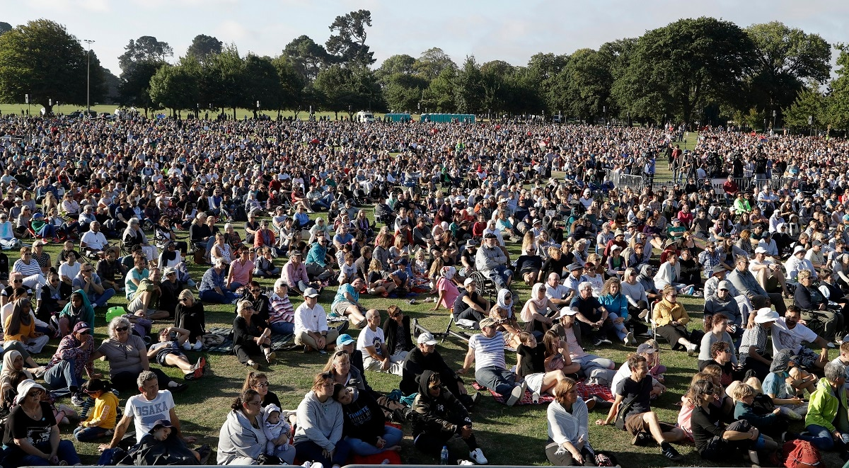 People gather for a vigil in Hagley Park following the March 15 mass shooting in Christchurch. (AP Photo/Mark Baker)