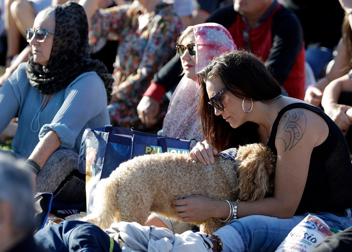 People attend a vigil in Hagley Park following the March 15 mass shooting in Christchurch. (AP Photo/Mark Baker)