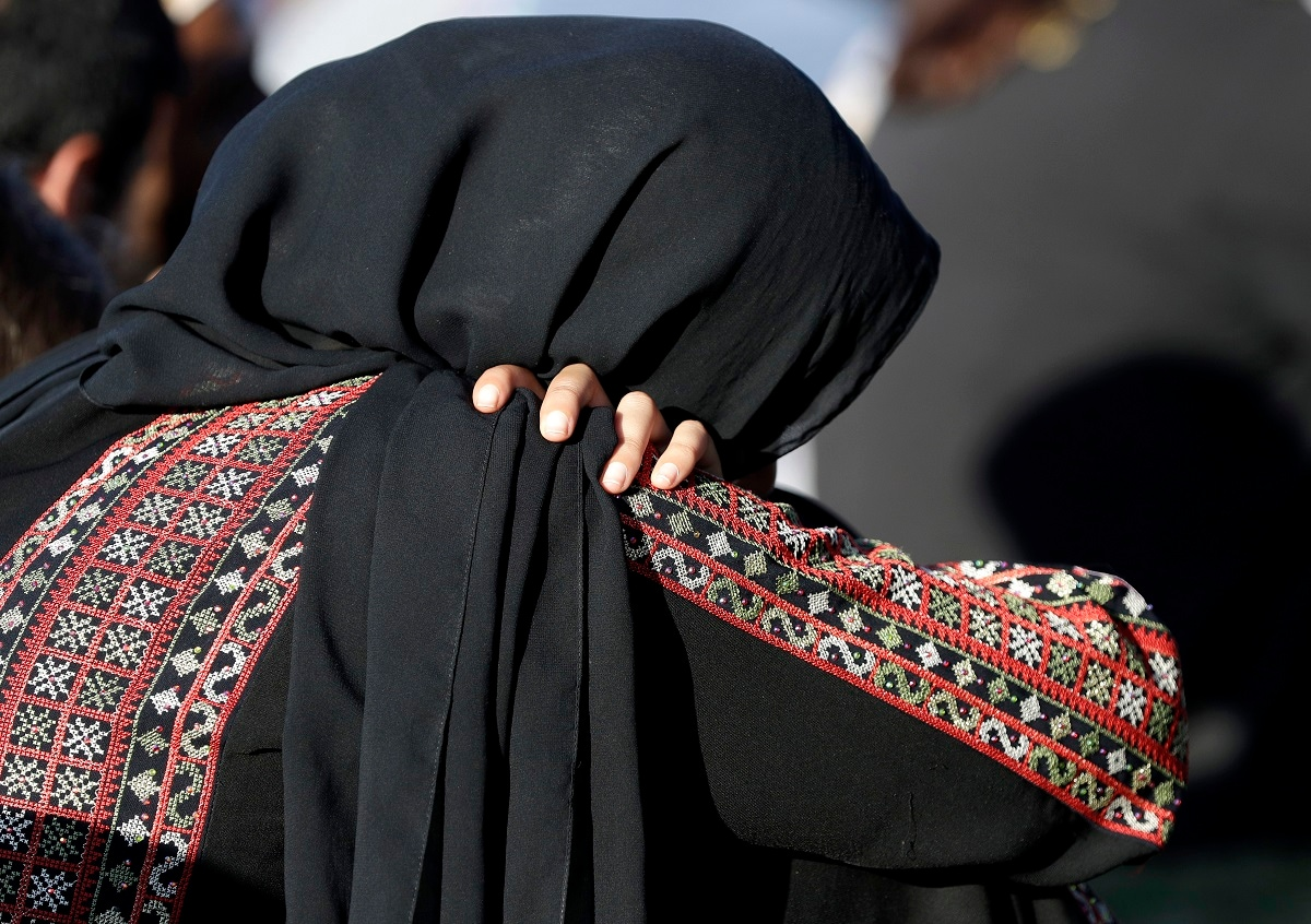 A Muslim woman attends a vigil in Hagley Park following the March 15 mass shooting in Christchurch. (AP Photo/Mark Baker)