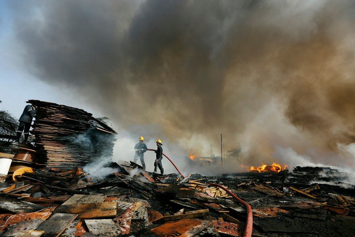 Firemen work to douse a fire at a wood warehouse near Pirana in Ahmadabad. No casualty has been reported from the fire. (AP Photo/Ajit Solanki, File)