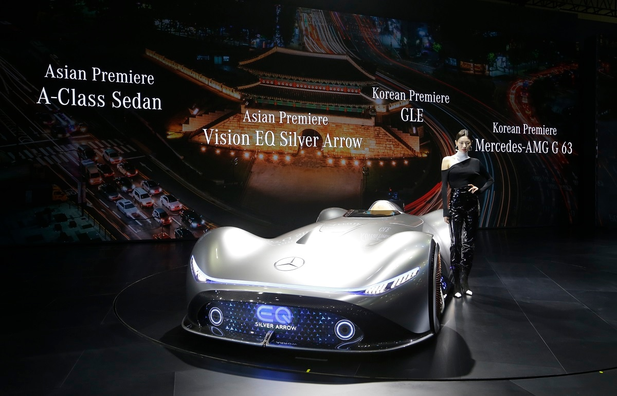 A model poses with a Mercedes-Benz EQ Silver Arrow during a media preview of the Seoul Motor Show in Goyang, South Korea.  (AP Photo/Ahn Young-joon, File)