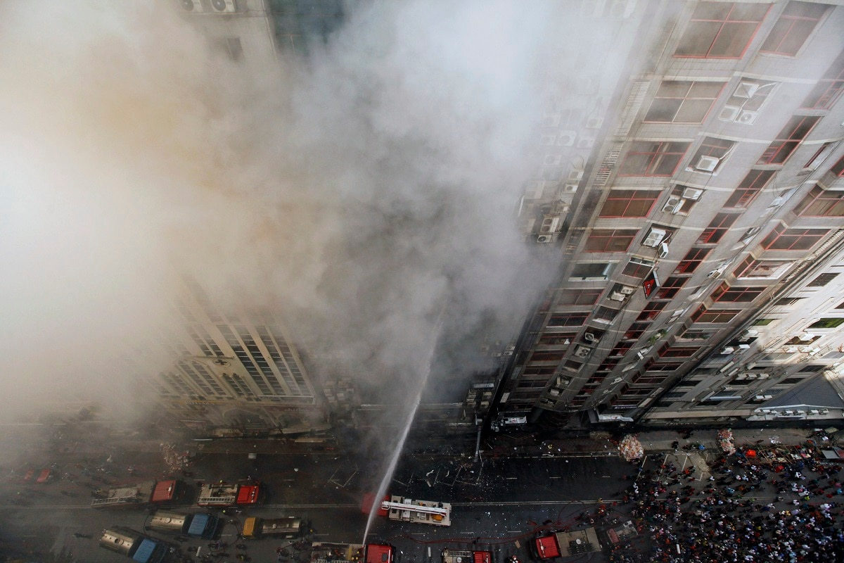 Firefighters work to douse a fire in a multi-storied office building in Dhaka, Bangladesh. The fire in the high-rise office building in Bangladesh's capital was brought under full control. (AP Photo/Mahmud Hossain Opu, File)
