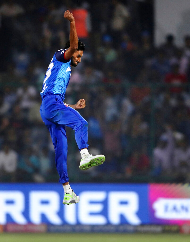 Delhi Capitals Harshal Patel leaps in the air to celebrate the dismissal of Kolkata Knight Riders Robin Uthappa during the VIVO IPL T20 cricket match between Delhi Capitals and Kolkata Knight Riders in New Delhi, India, Saturday, March 30, 2019. (AP Photo/Altaf Qadri).