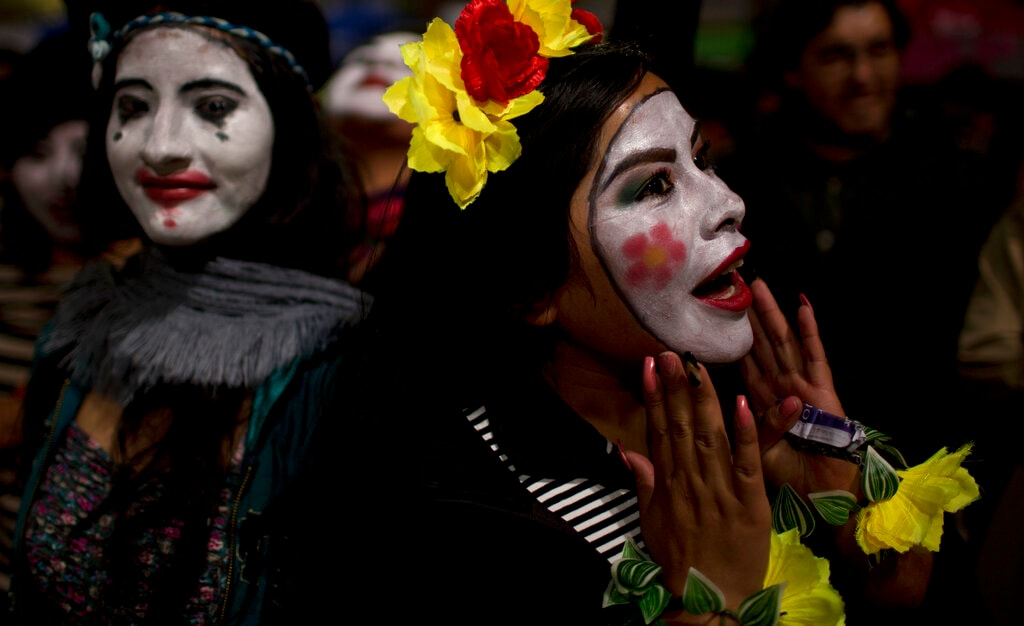 Mimes take part in a candlelight vigil marking Earth Hour in La Paz, Bolivia, Saturday, March 30, 2019. Earth Hour takes place worldwide and is a global call to turn off lights for 60 minutes in a bid to highlight the global climate change. The Earth Hour was started in Australia in 2007, which has become a global event. (AP Photo/Juan Karita).