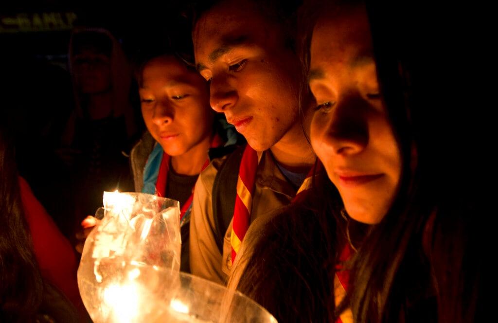 People take part in a candlelight vigil marking Earth Hour in La Paz, Bolivia, Saturday, March 30, 2019. (AP Photo/Juan Karita).