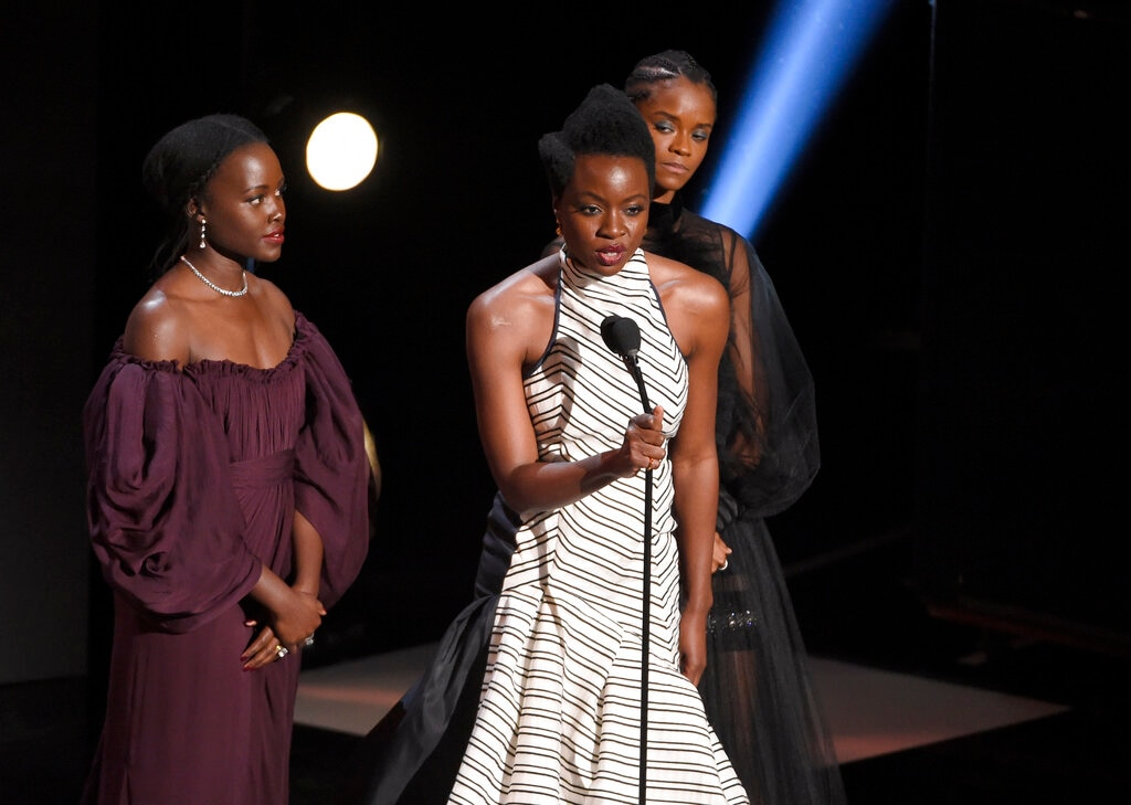 Lupita Nyong'o, from left, Danai Gurira, and Letitia Wright accept the award for outstanding motion picture for