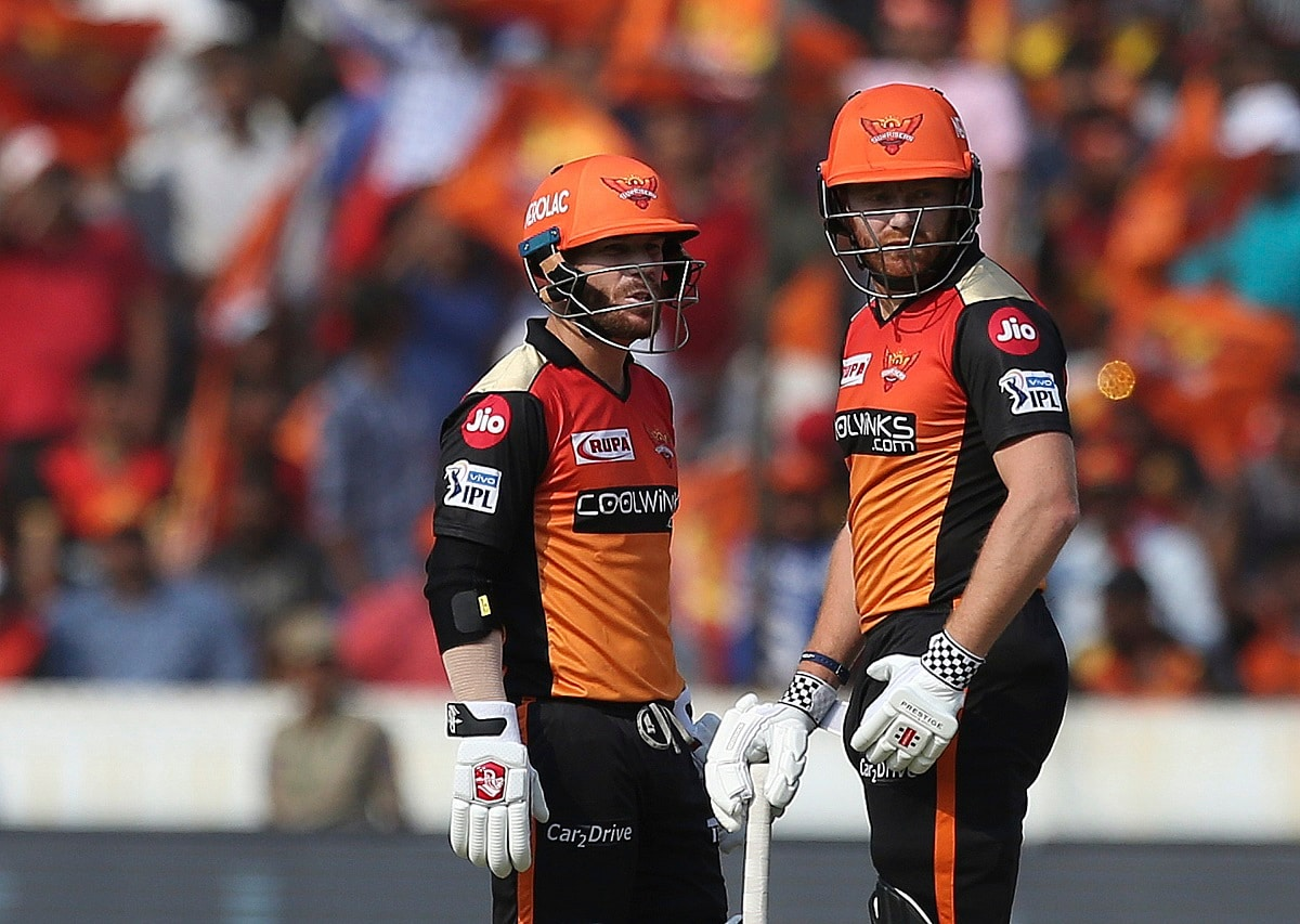 Sunrisers Hyderabad's David Warner, left, and Jonny Bairstow talk between the wickets against Royal Challengers Bangalore during the VIVO IPL T20 cricket match in Hyderabad. (AP Photo/ Mahesh Kumar A.)