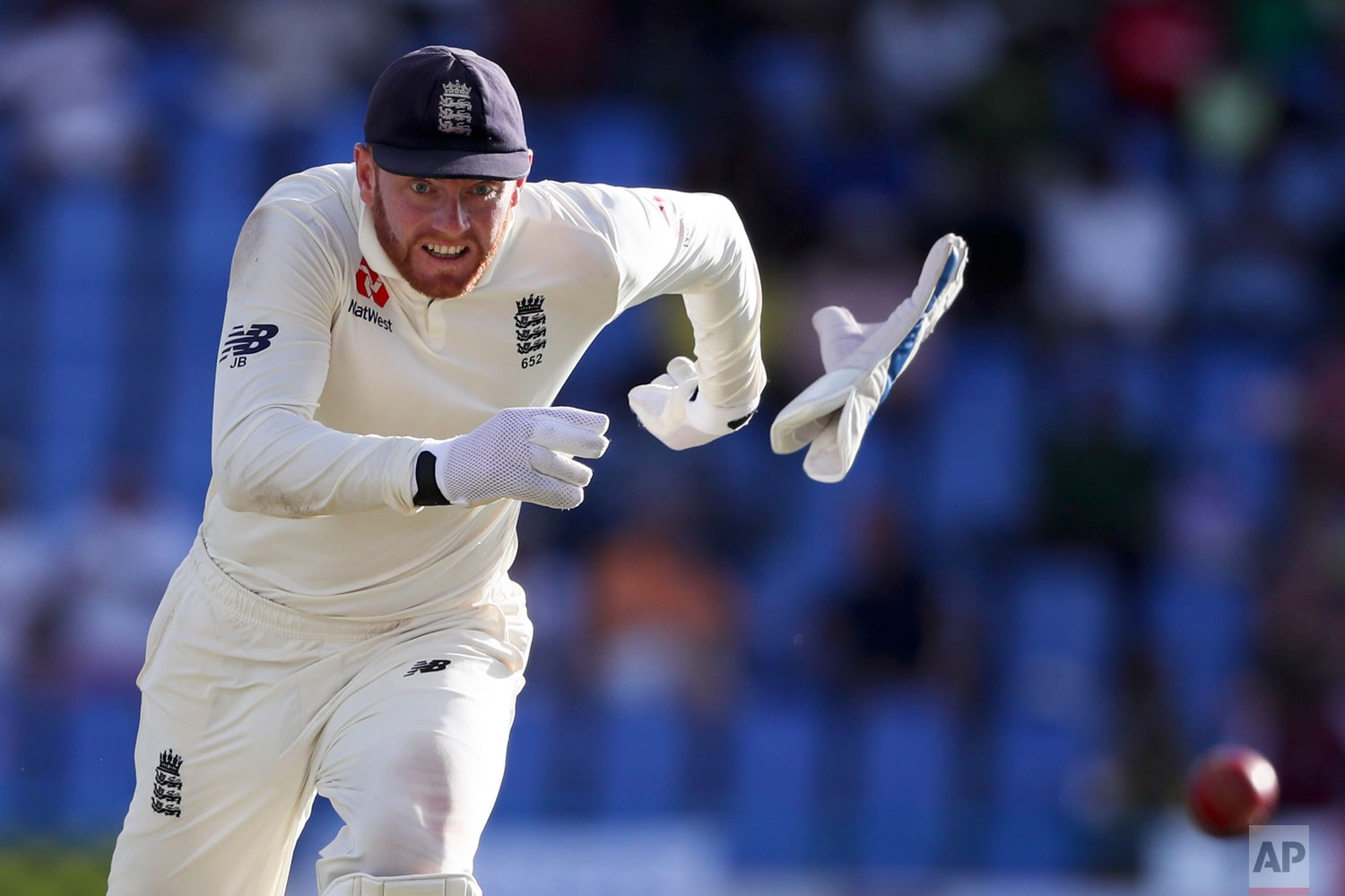 England'swicketkeeperr Jonny Bairstow runs to stop a shot played by West Indies' Darren Bravo during day two of the second Test cricket match at the Sir Vivian Richards Stadium in North Sound, Antigua and Barbuda, Friday, February 1, 2019. (AP Photo/Ricardo Mazalan)