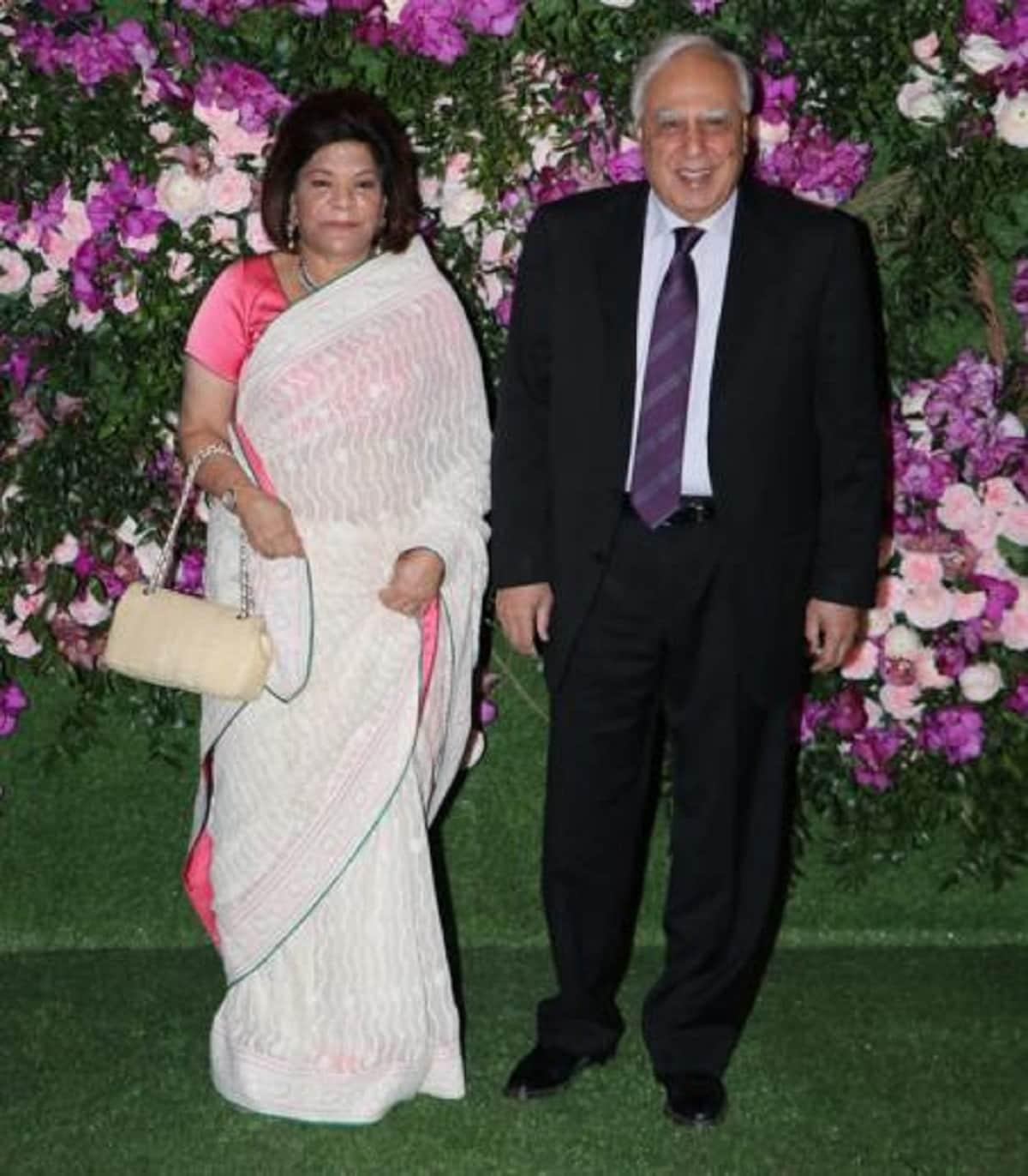 Politician Kapil Sibal and his wife Promila Sibal attend Akash Ambani and Shloka Mehta's wedding. (Image: Viral Bhayani)