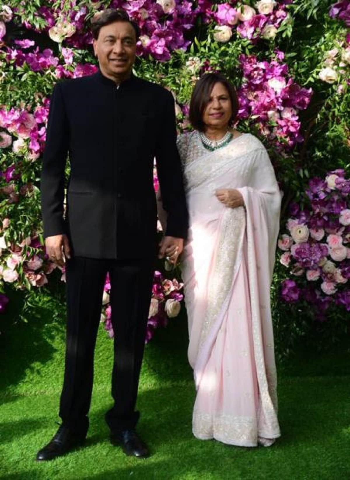 Indian steel magnate Lakshmi Mittal and his wife Usha Mittal grace Akash Ambani and Shloka Mehta's wedding. (Image: Viral Bhayani)