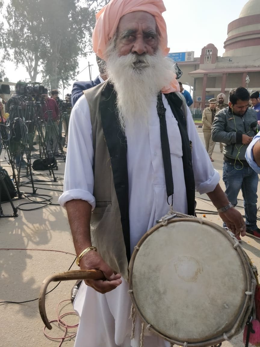 A man with drums is all geared up to welcome wing commander Abhinandan Varthaman home as media persons setup cameras for the countdown at the Wagah Border, Attari, Punjab. (Credits: News18 video journalist Neeraj)