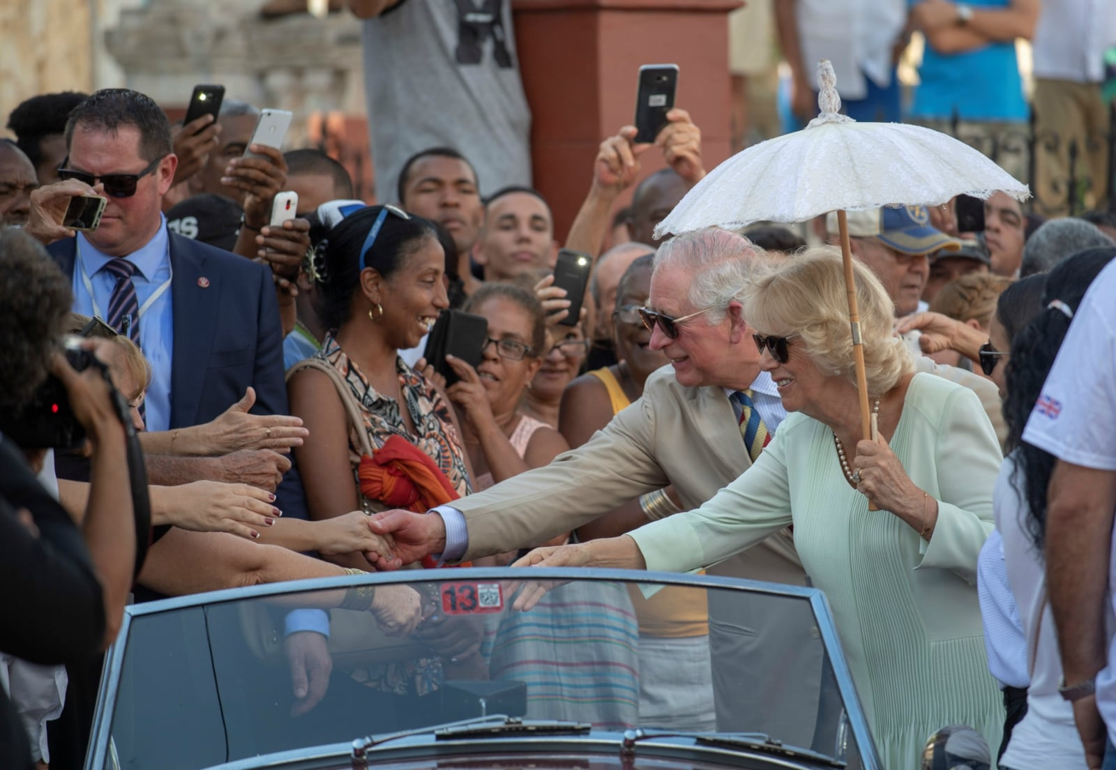 Britain's Prince Charles and Camilla, Duchess of Cornwall meet locals at a British Classic Car event in Havana, Cuba March 26, 2019. Arthur Edwards/Pool via REUTERS