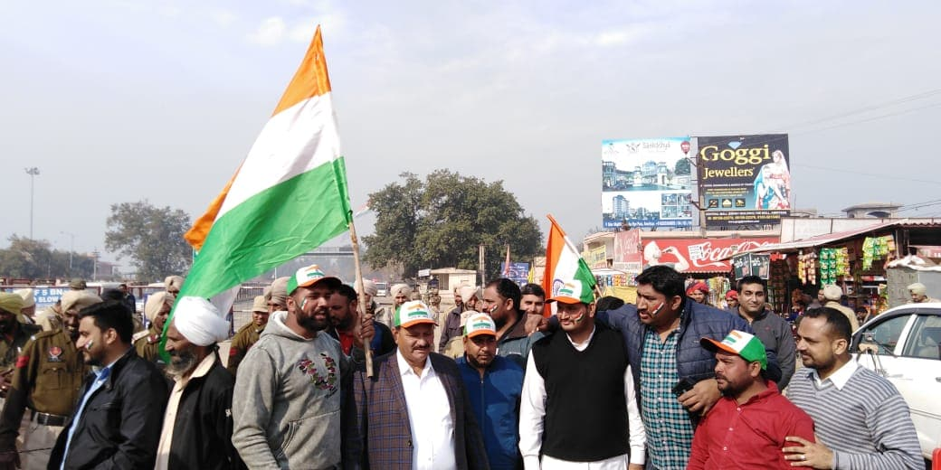 With the Indian flag in their hands, civilians celebrate the return of Indian Air Force commander Abhinandan Varthaman at the Wagah Border, Attari, Punjab. (Credits: News18 video journalist Neeraj)