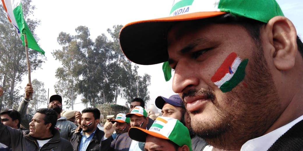 Civilians with Indian National Flag painted on their faces celebrate the return of wing commander Abhinandan Varthaman at the Wagah Border, Attari, Punjab. (Credits: News18 video journalist Neeraj)