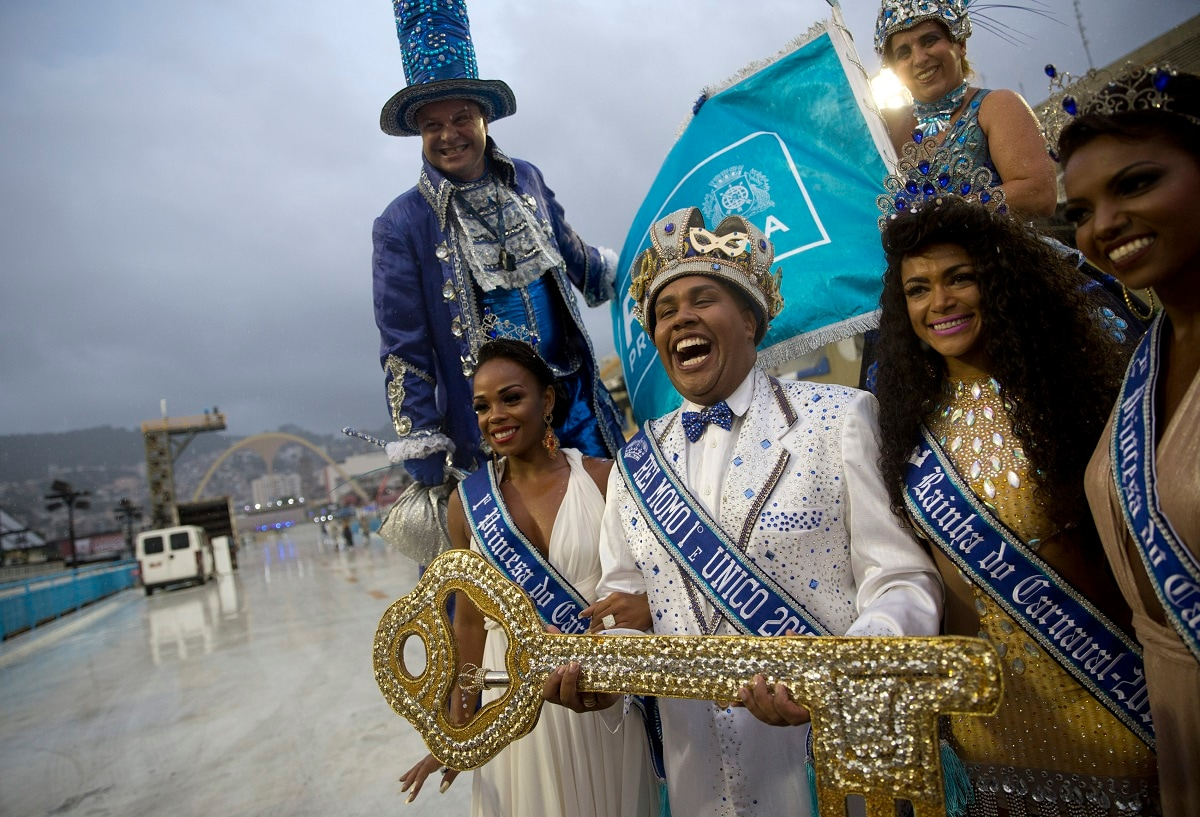 Carnival King Momo Wilson Neto, center holds the key to the city at a ceremony marking the official start of Carnival at the Sambadrome, in Rio de Janeiro, Brazil. (AP Photo/Silvia Izquierdo)