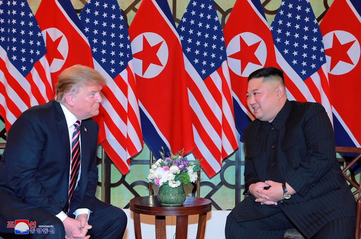 North Korea's leader Kim Jong Un and US President Donald Trump speak during the second US-North Korea summit in Hanoi. (KCNA via REUTERS)