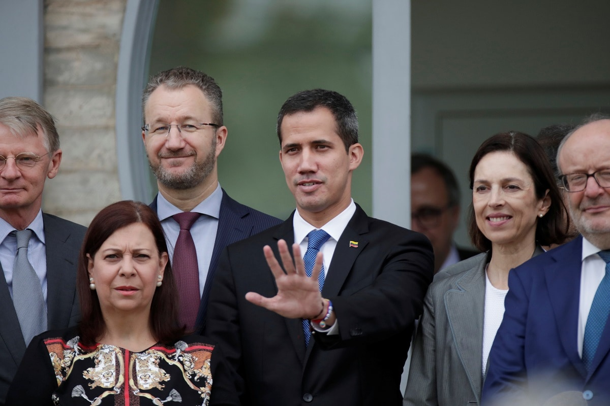 Venezuelan opposition leader Juan Guaido poses for a photo after a meeting at the European Union headquarters. (REUTERS/Ueslei Marcelino)