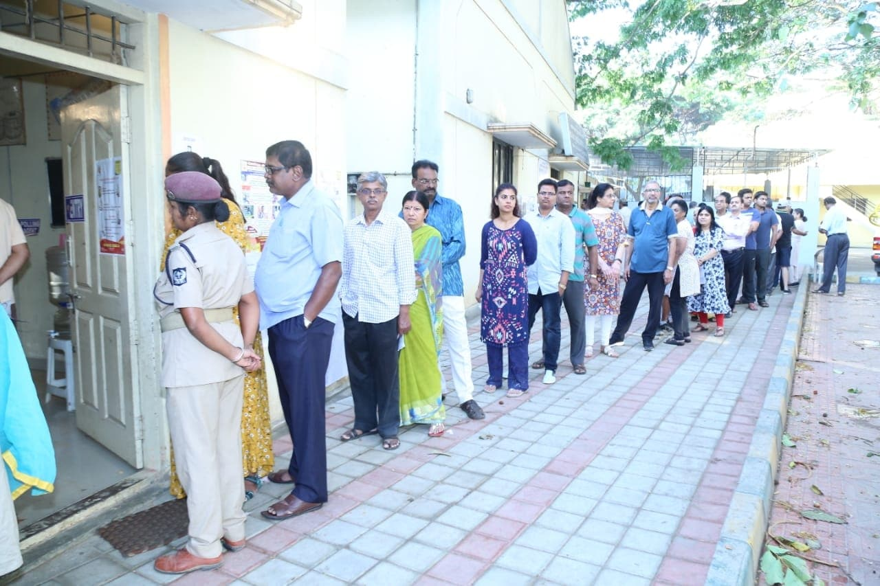 People standing in a queue to cast their vote for Lok Sabha election in Bengaluru on April 18, 2019. (Photo: IANS)