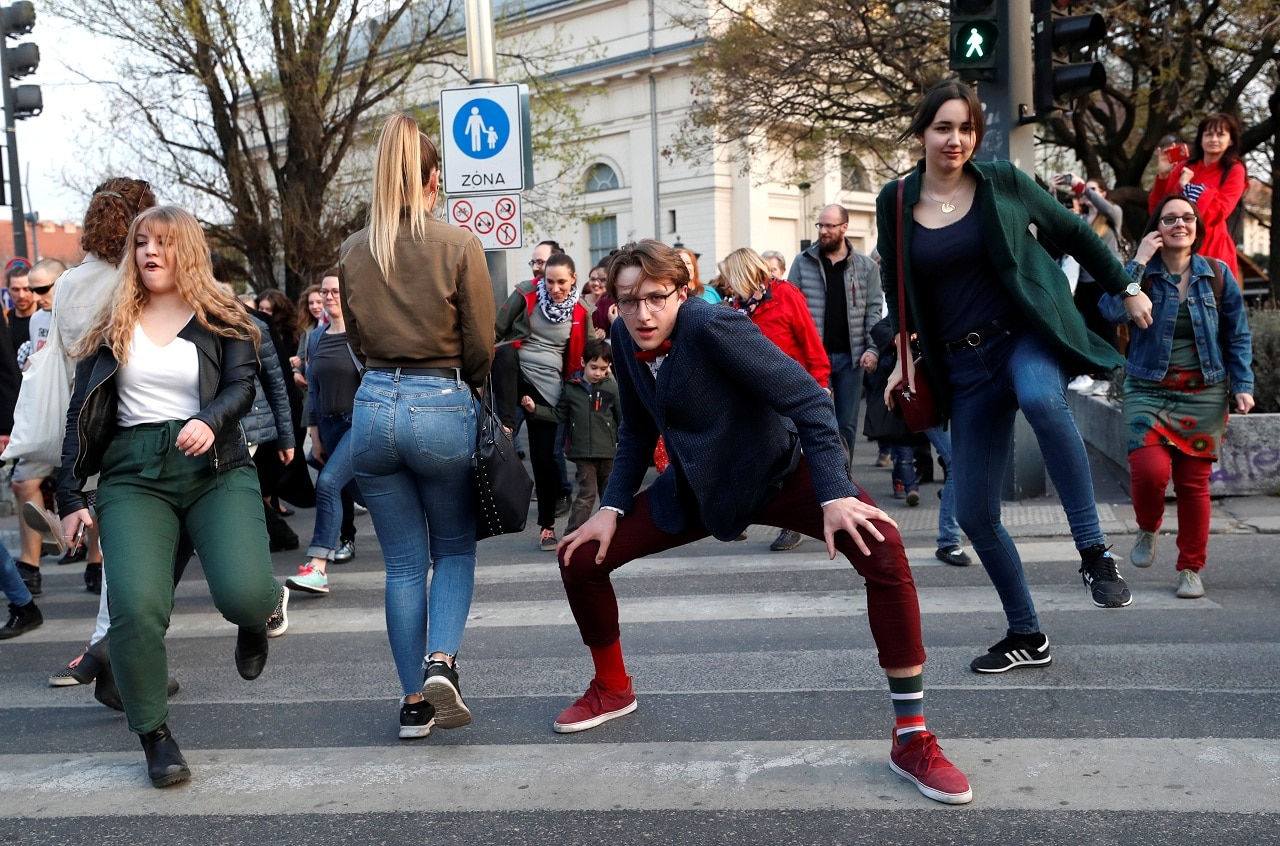 People attend the Silly Walk Parade, emulating a sketch from British comedy group Monty Python's television series to mark April Fool's day in Budapest, Hungary, April 1, 2019. (Reuters)