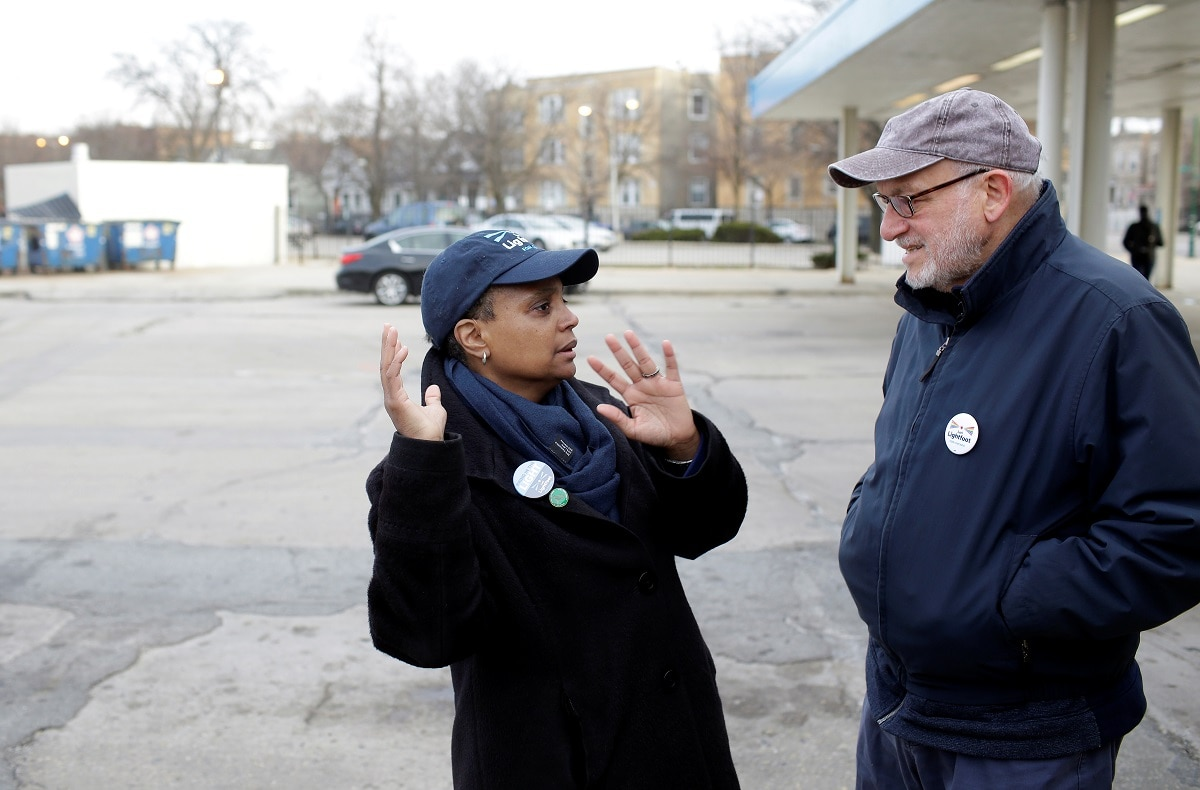 Chicago mayoral candidate Lori Lightfoot speaks with a supporter at the Logan Square Blue Line station during a runoff election for mayor against Toni Preckwinkle in Chicago. (REUTERS/Joshua Lott)