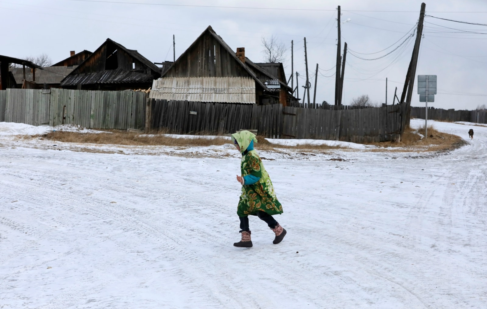 A girl runs before the beginning of a performance on the occasion of Maslenitsa, also known as Pancake Week, which is a pagan holiday marking the end of winter, in a street of a Siberian settlement founded as a logging camp and part of the Soviet Union's Gulag prison labour system, Tugach, southeast of Krasnoyarsk, March 10, 2019. REUTERS/Ilya Naymushin
