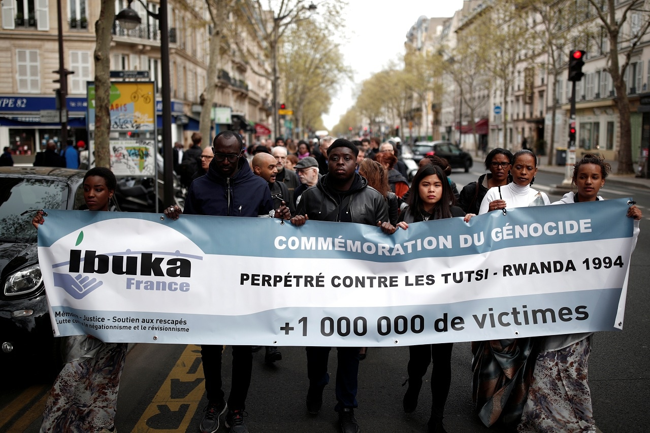 People take part in a silent walk to commemorate the 25th anniversary of the Rwandan genocide in Paris, France, April 7, 2019. (Reuters)