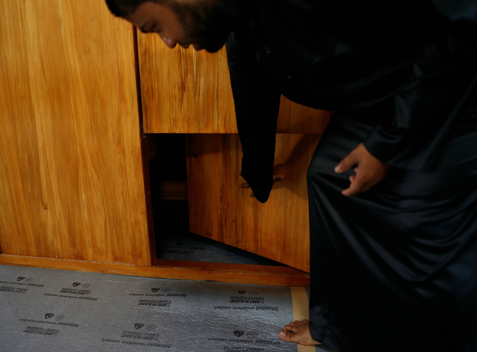 Mohammed Israfil Hossain, a muazzin from Bangladesh, shows an opening in the pulpit where a three-year-old boy hid during the shootings at Al Noor mosque where more than 40 people were killed by a suspected white supremacist during Friday prayers on March 15 in Christchurch, New Zealand April 1, 2019. REUTERS/Edgar Su