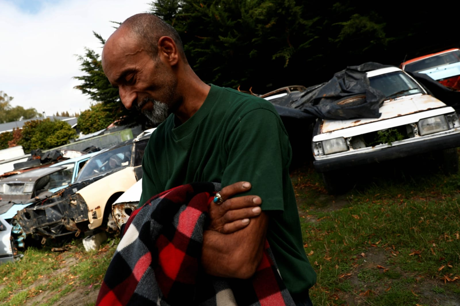 Omar Nabi, 43, originally from Afghanistan, takes a moment to recompose himself as he speaks about his late father, Haji-Daoud Nabi's love for cars at Haji-Daoud's property in Christchurch, New Zealand March 31, 2019. REUTERS/Edgar Su