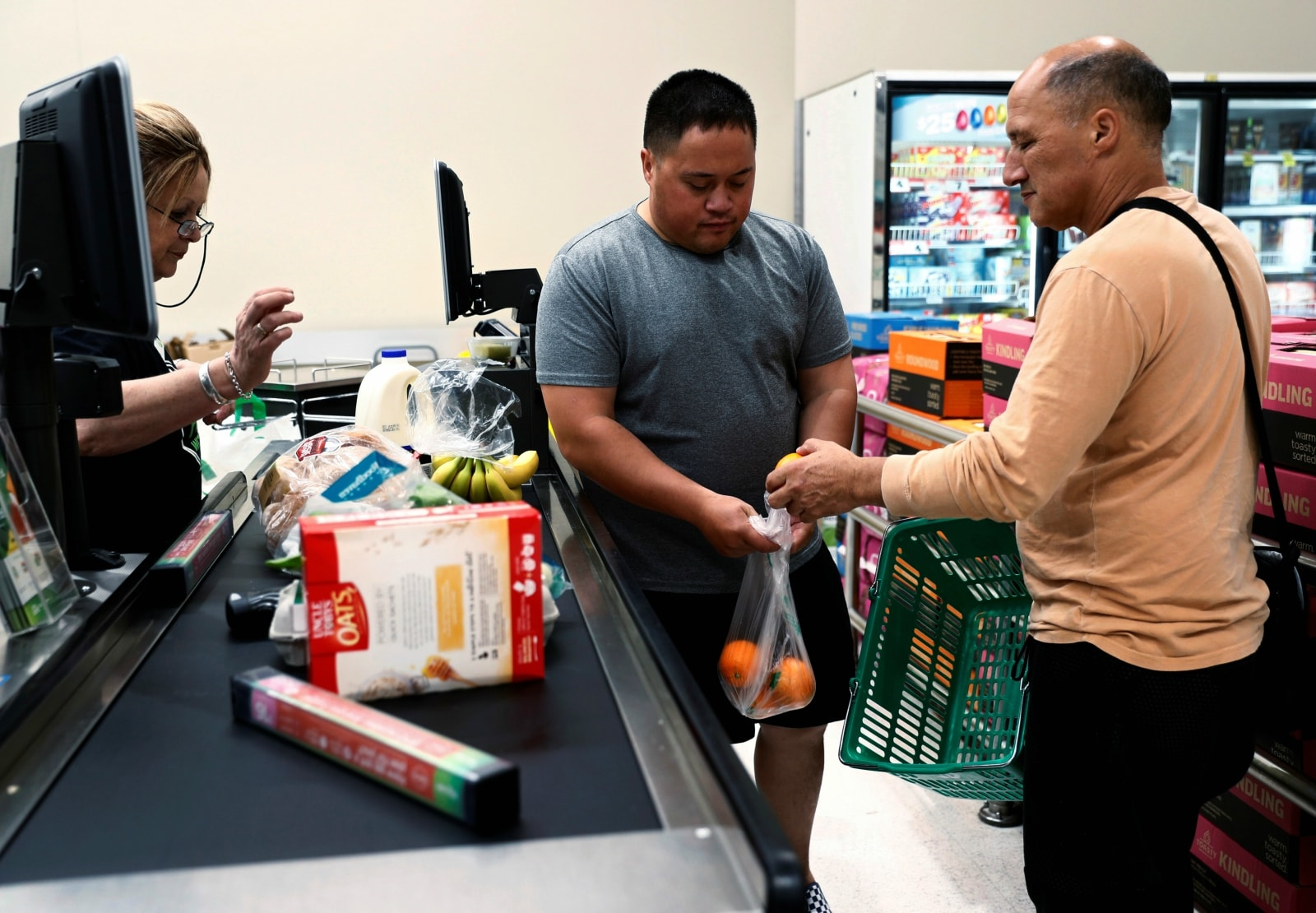 Mark Rangi, a New Zealander based in Sydney and a survivor of Christchurch shootings, shops for groceries with his son Sam at a supermarket in Christchurch, New Zealand, March 27, 2019. REUTERS/Edgar Su