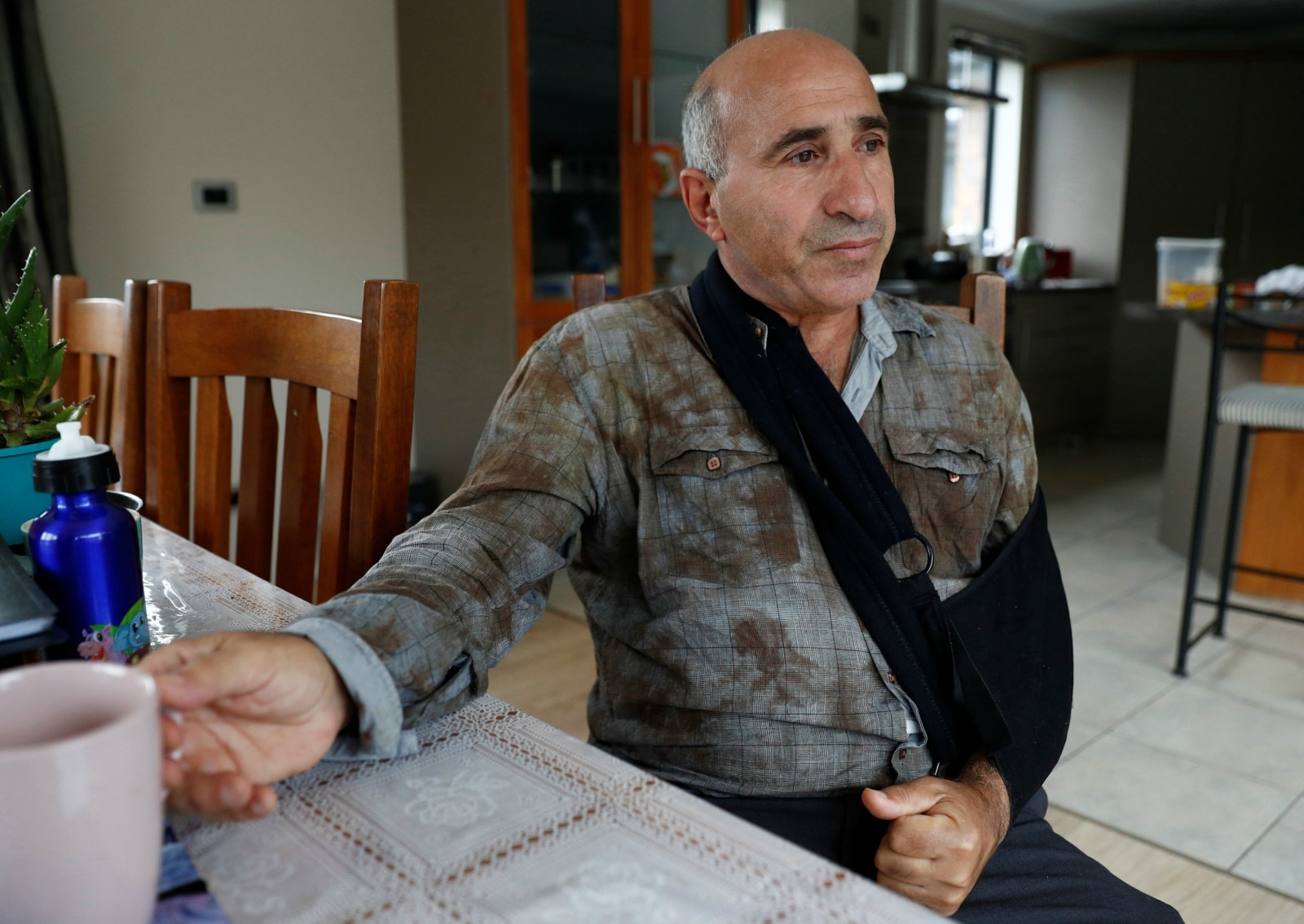 Hazem Mohammed, who migrated from Iraq 41 years ago, the survivor of the Christchurch shootings, speaks about experiences during the attacks, at his home in Christchurch, New Zealand, March 26, 2019. REUTERS/Edgar Su