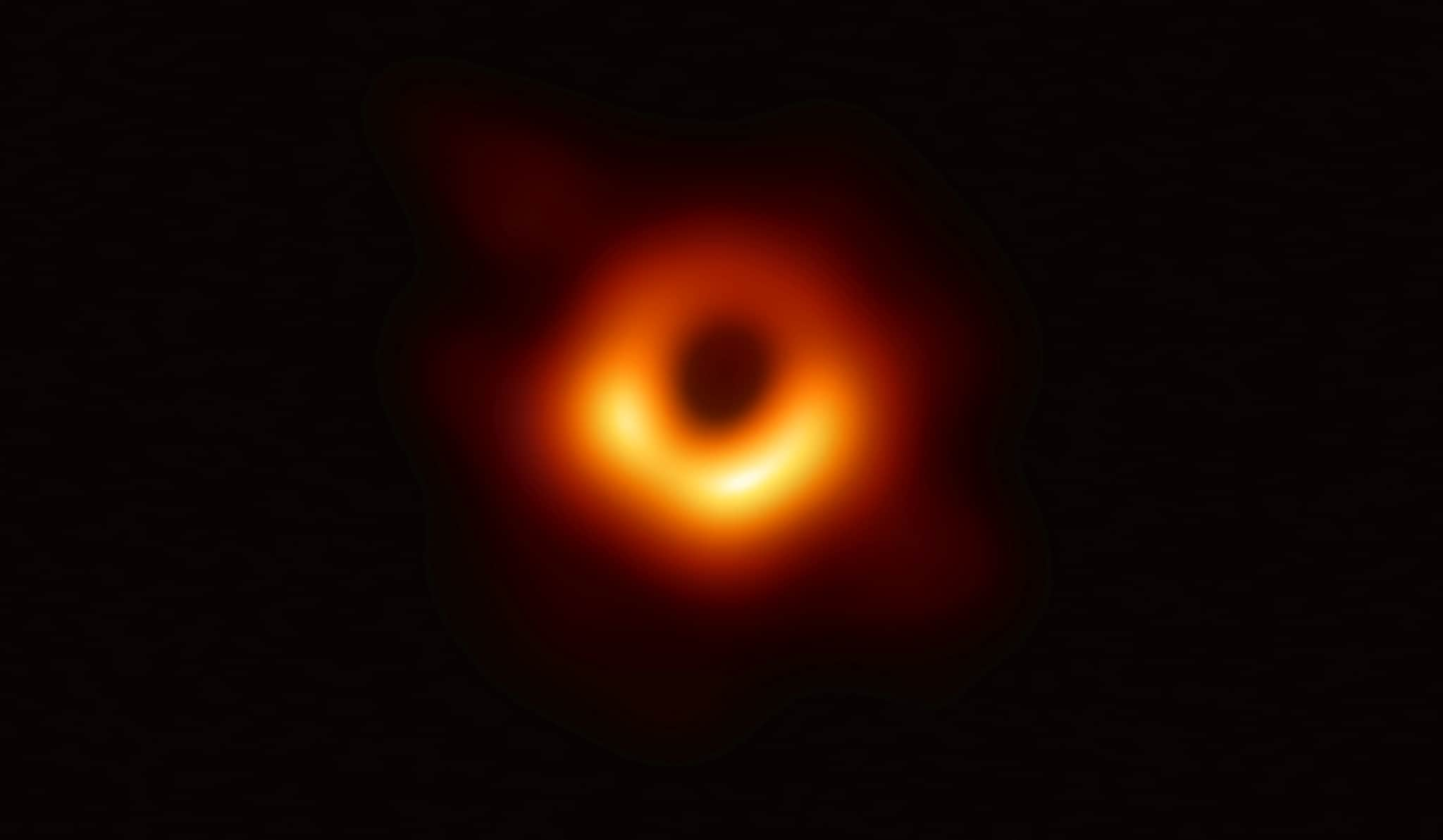 The first ever photo a black hole, taken using a global network of telescopes, conducted by the Event Horizon Telescope (EHT) project, to gain insight into celestial objects with gravitational fields so strong no matter or light can escape, is shown in this handout photo released April 10, 2019. Event Horizon Telescope (EHT)/National Science Foundation/Handout via REUTERS